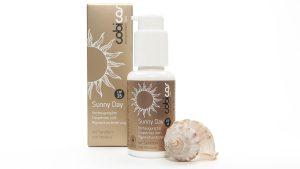 Sunny Day Cream LSF15 von cobicos. Verpackung und Flasche mit Muschel
